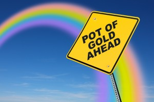 pot of gold road sign with rainbow