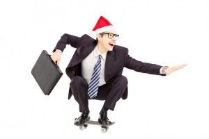 businessman in santa hat on skateboard