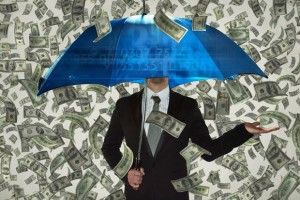 man holding umbrella while it's raining money